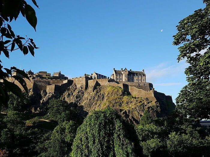Edinburgh Castle with blue sky and moon