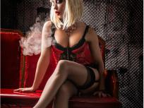 Blonde seductress smoking on web cam