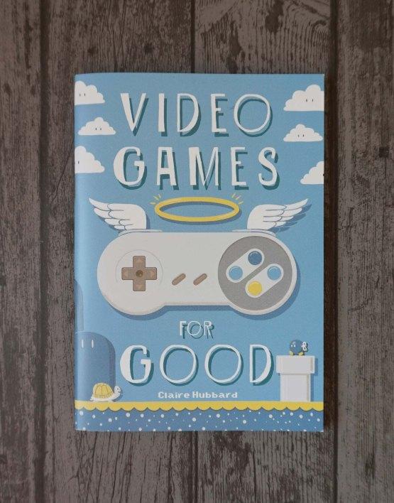 Das Titelbild von Video Games for Good zeigt enen Super Nintendo Controller mit Heiligenschein und Flügelchen.