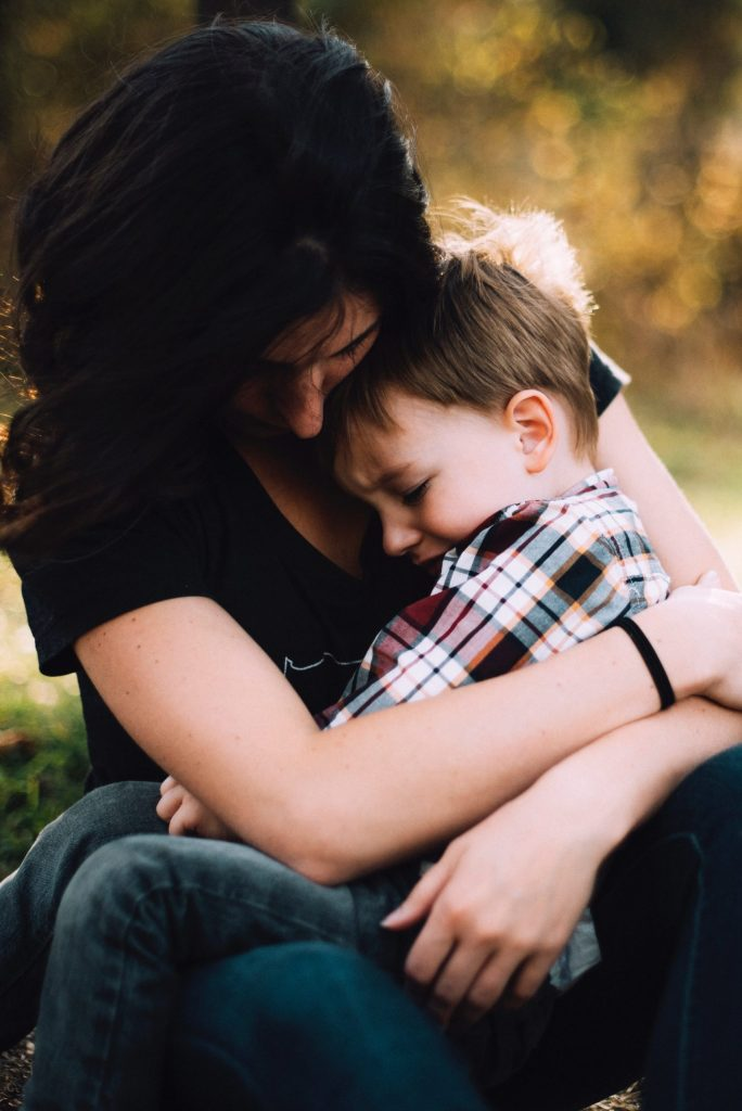 Woman holding crying child