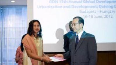 Hasina Kharbhih in Budapest receiving the GDN Award
