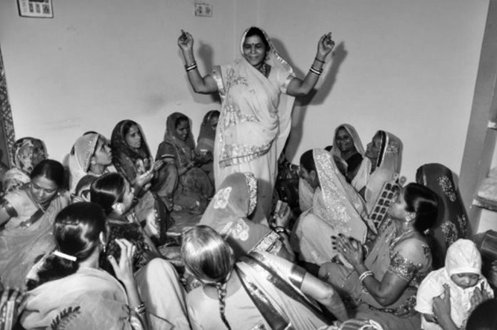 Women at Leisure: Women from a neighborhood got together for a wedding and help hosts attend to guests who have come from far and wide. Once done with the chores, they got together to sing and dance together.