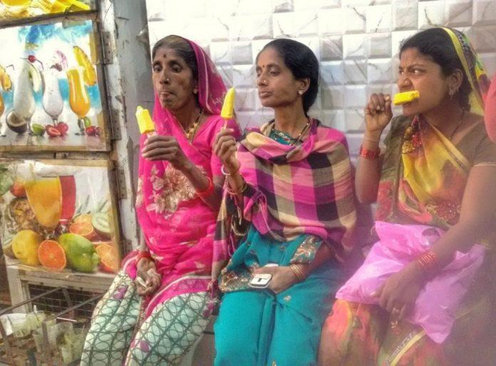 Women at Leisure: Women enjoying an ice cream break on a hot summer afternoon.