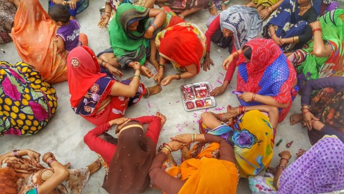 Women at Leisure: Women in a village got together to mourn and celebrate the death of someone who died after a full life. They help each other get ready for Tehravi, the grand feast arranged after someone dies.