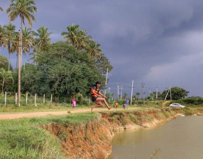 Women at Leisure: Deepa jumping into a pond which got some water due to unexpected rain