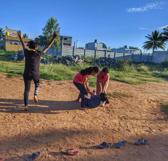 Women At Leisure: Girls playing Kabaddi early in the morning. Rinki jumps in joy as Kajal from the opposition team is taken down by her team members, Ravina and Neelam.