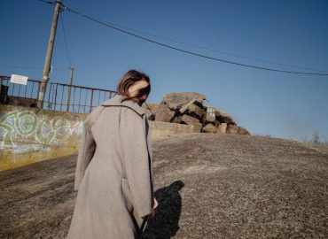 Young woman warm coat back shadow femlens