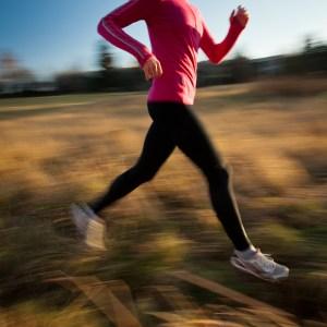 Woman-running-in-autumn