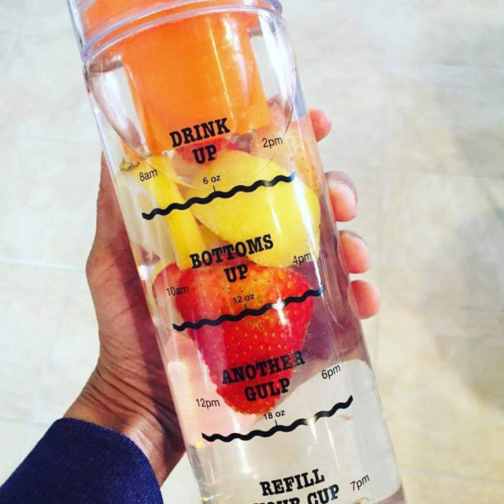 Orange infusion water bottle with fruit