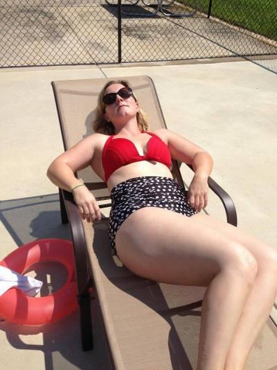 Rachel Harrison laying poolside