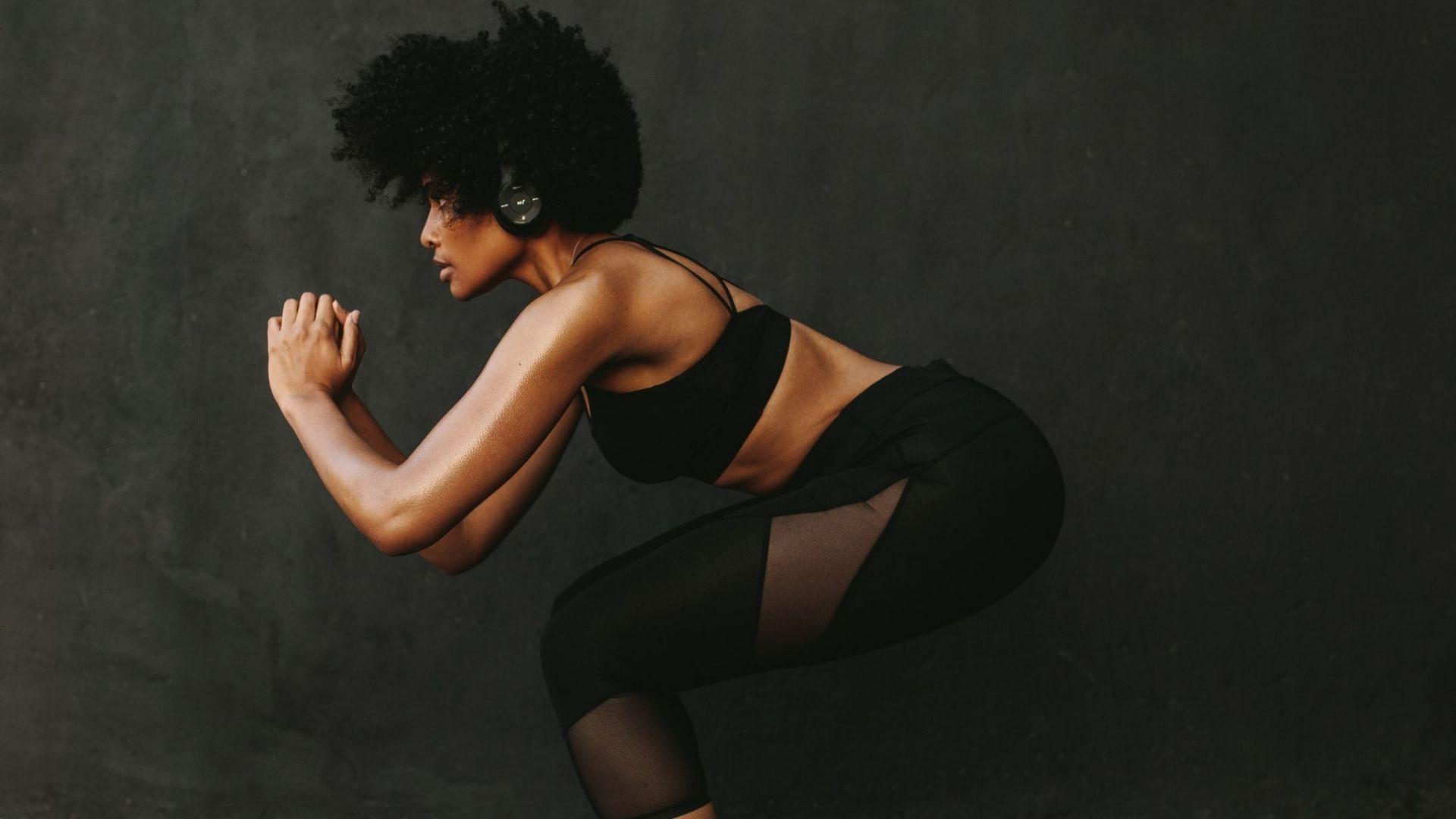 women performing a squat