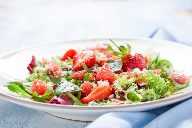 tasty-salad-with-strawberries - Here's why you aren't losing weight eating salads. #salads #veggies #vegan #saladjam