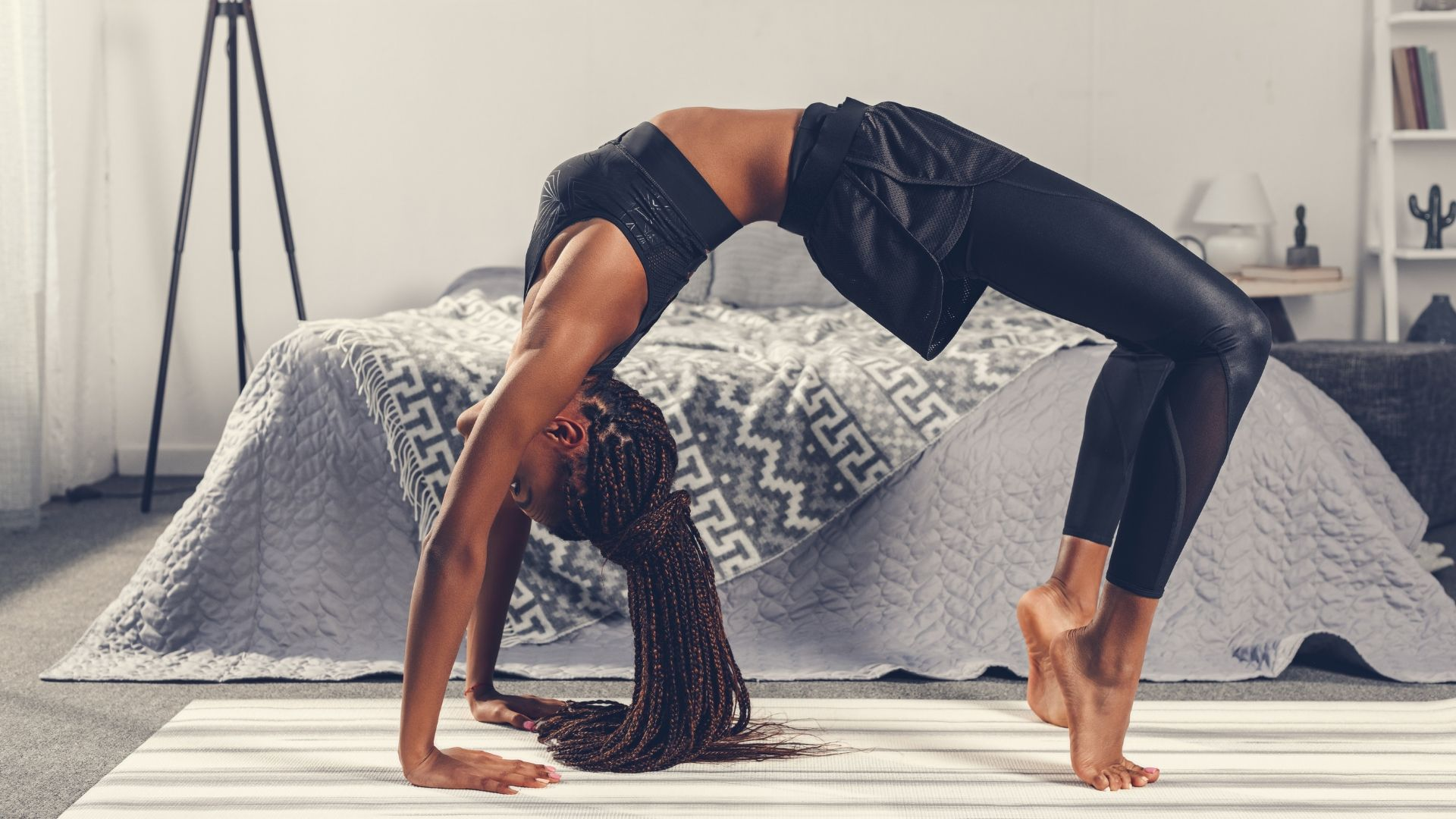 Black woman posing doing yoga