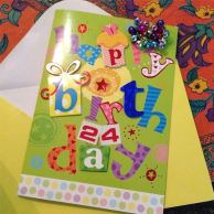 Birthday card with birthday earrings that I wore all day of course