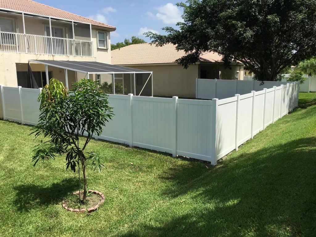 wichita falls fencing installation company finishing a white pvc fence