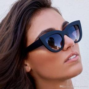 model wearing cateye sunglasses