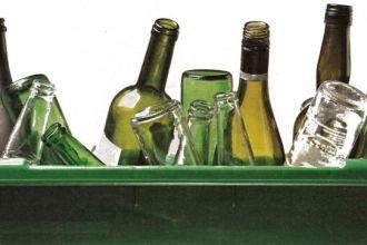 recycling bin full of glass bottles