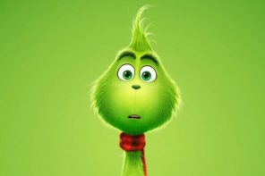 the grinch movie poster - a small baby grinch staring helplessly into the camera, or perhaps a void