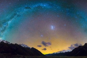 a photo from the dark sky reserve in aoraki showing a beautiful halo of stars over the mountains