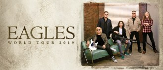 rock band the eagles pose for a promo shot for their world tour lounging in a weather-beaten room with a green couch