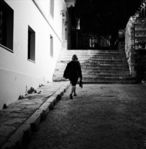 A-woman-walking-in-the-dark--by-nasos-zovoilis