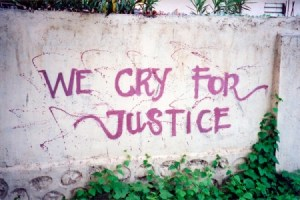 Graffiti on a wall in Manatuto, Timor-Leste taken in March 2001, it says 'We cry for justice'.