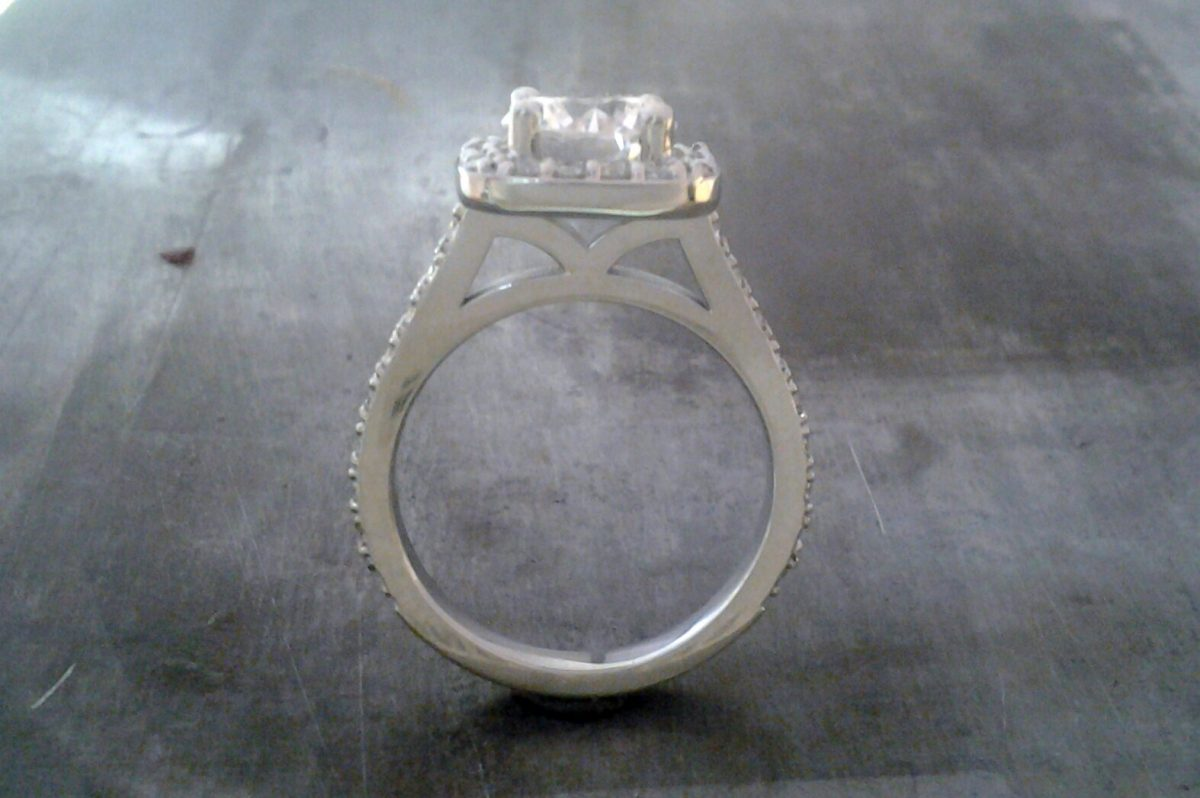 princess cut diamond and halo setting side view