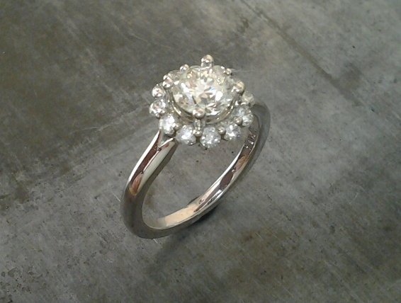 classic vintage style white gold engagement ring with round cut diamond in a halo setting top view