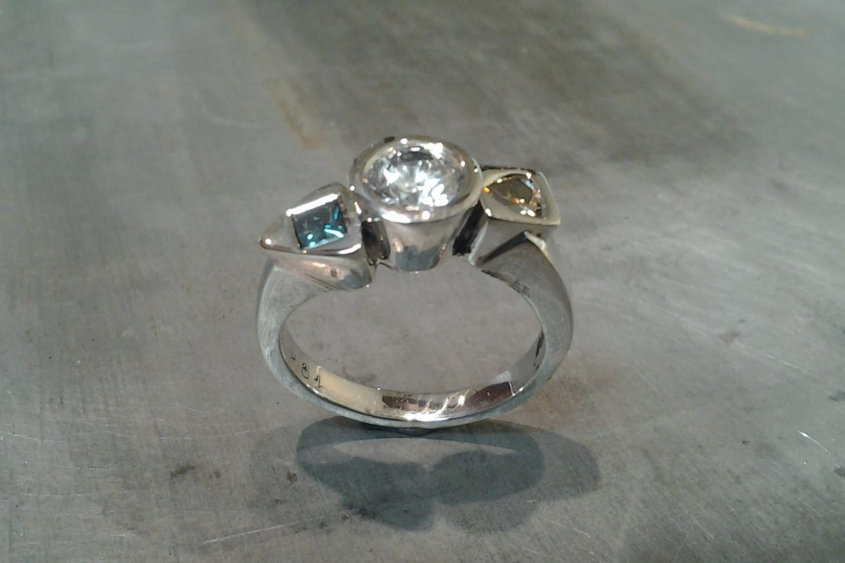 unique custom white gold engagement ring with custom set diamond and sapphire