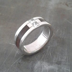 custom white gold wedding ring with wood inlay and center diamond