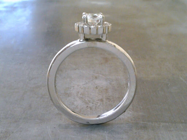 minimalist custom designed band with a princess cut diamond in a flower halo setting side view