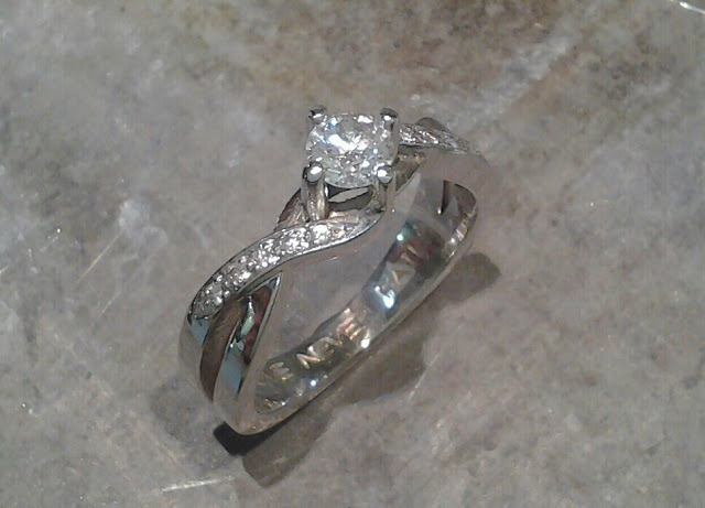 custom designed swirled band by sean ferguson with round diamond in channel setting