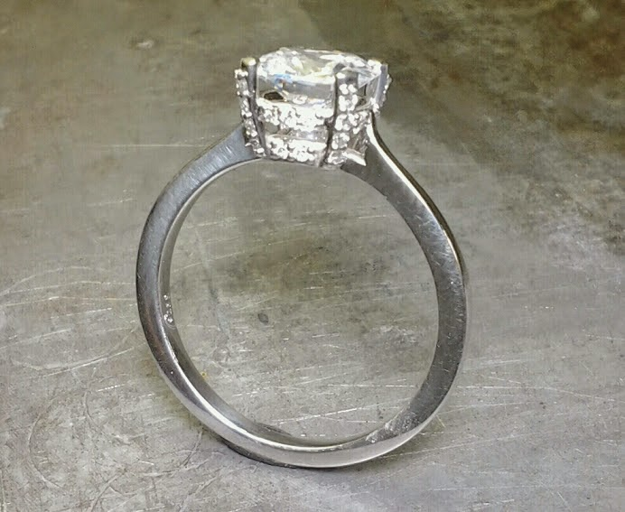 14k white gold slim band engagement ring with large princess cut diamond in a custom engraved channel setting