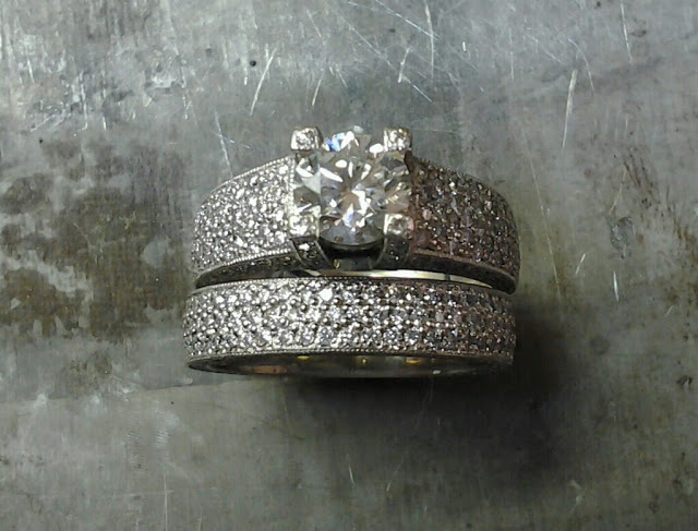 custom engraved engagement ring with princess diamond in channel setting and matching wedding band top view