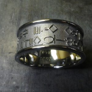 custom wedding ring with symbol engraving top view