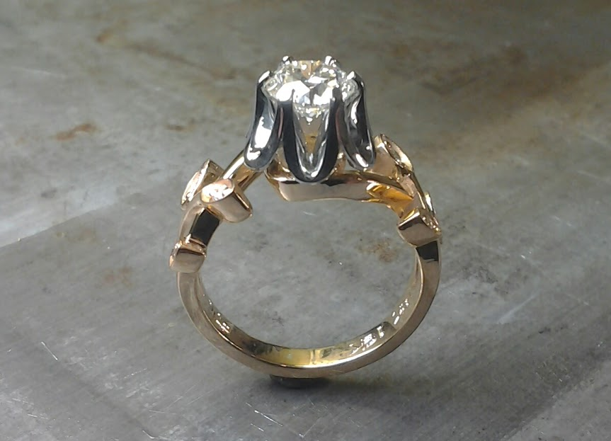 white gold and rose gold custom designed leaf band and princess cut diamond in cathedral setting