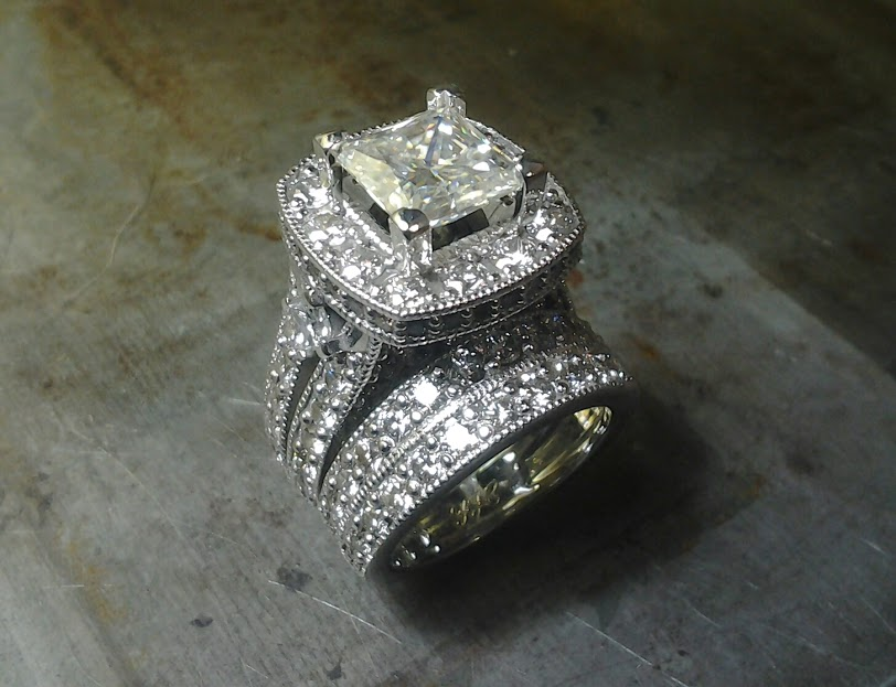 diamond encrusted engagement ring with large center stone and matching diamond wedding band top view