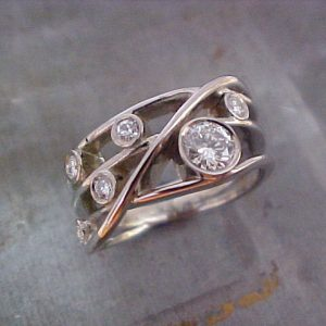 custom swirl wedding ring with round diamonds