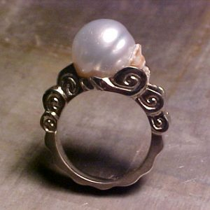 ocean inspired ring with custom engraving and large center pearl