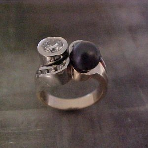 custom ring with white gold and black pearl
