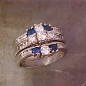 custom ring with 14k white gold and blue sapphires