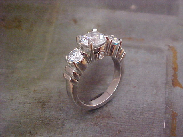 custom engagement ring in 14k white gold with three large diamonds
