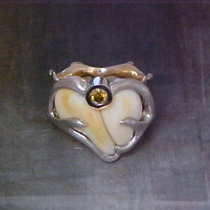 nature inspired ring with custom antler engraving, bone and yellow sapphire