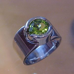large platinum ring with round emerald in center