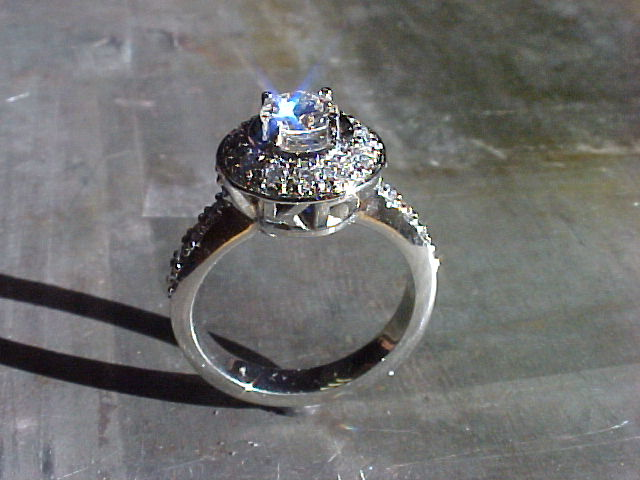 14k white gold custom engagement ring with custom monogram engraving and halo setting