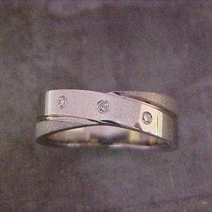 custom textured wedding ring with diamond accents