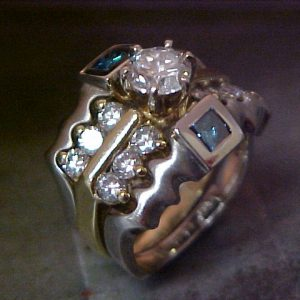 custom fit white and yellow gold ring with diamonds and sapphires