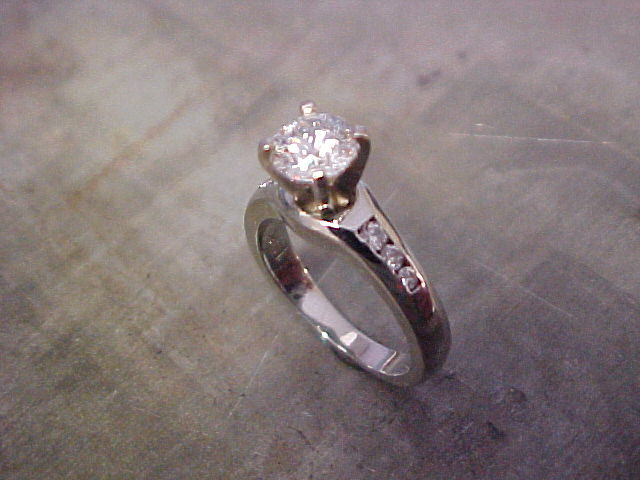 custom solitaire engagement ring with large princess cut diamond and side accents