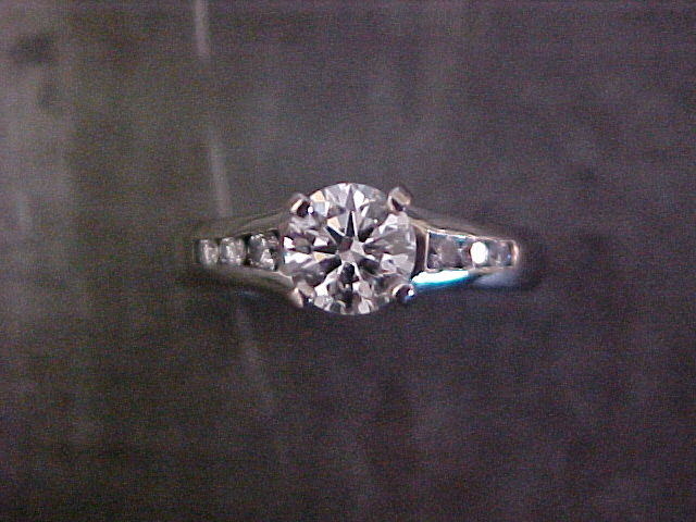 custom solitaire engagement ring with side accents