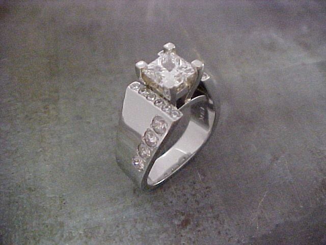 custom engagement ring with side accents and large center diamond